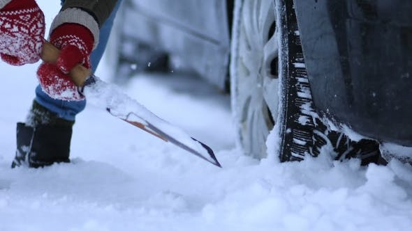 Thumbnail for of Woman Shoveling Snow From Car