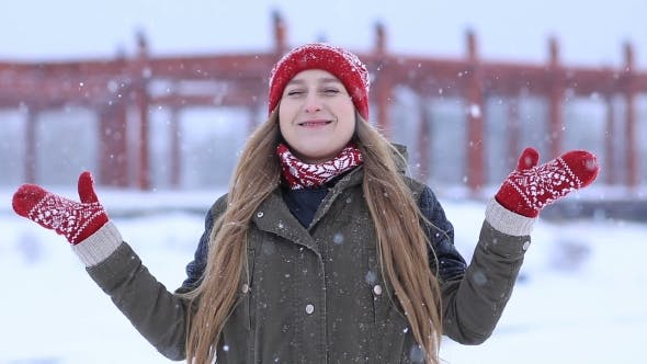 Thumbnail for Happy Young Woman Enjoying First Snow