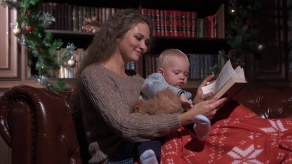 Cover Image for Mother with Her Child and Cat at Home Reading Book