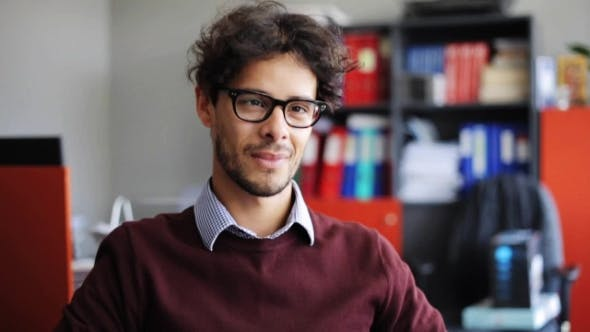Thumbnail for Smiling Young Man in Eyeglasses at Office