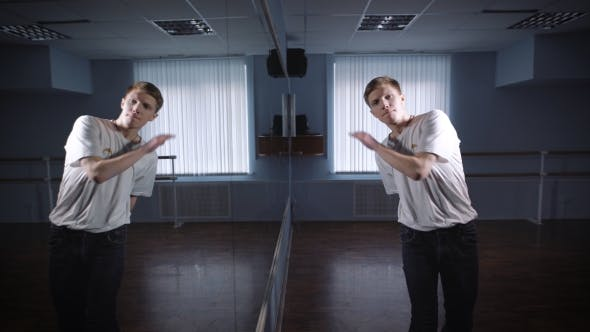 Thumbnail for Dancer in White Shirt and Jeans Showing Modern Breakdancing in Classroom with Mirrors and Ballet