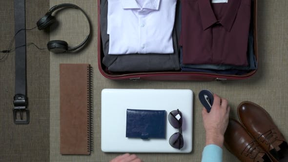 Thumbnail for Businessman Packing a Suitcase