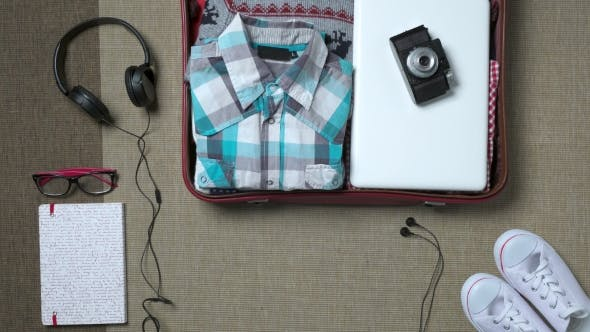 Thumbnail for Hipster Traveler Packing a Baggage