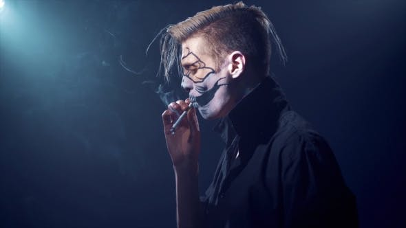 Thumbnail for an Evil Man with Halloween Makeup Smoking