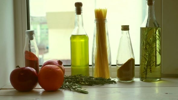 Thumbnail for Food Ingredients Near Kitchen Window. Cooking Oil and Kitchen Herbs
