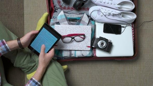 Thumbnail for Hipster Man Reading E-book
