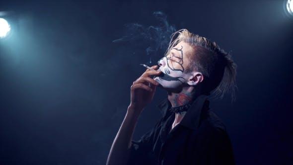 Thumbnail for Man with Halloween Makeup Smoking