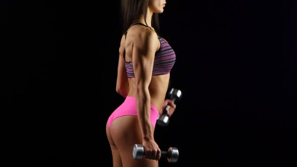 Thumbnail for Beautiful Fitness Woman with Lifting Dumbbells . Sporty Girl Showing Her Well Trained Body
