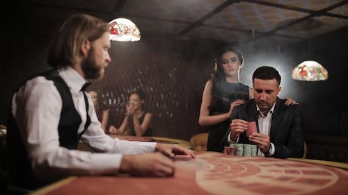 Solid Businessman with a Young Prostitute Played in Casino