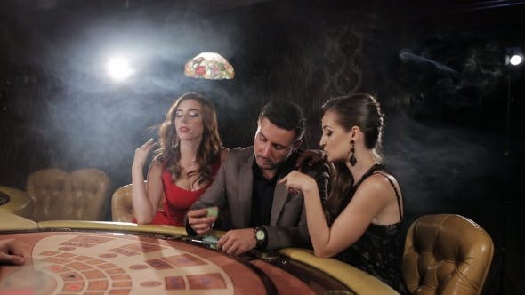 Thumbnail for The Rich Man Surrounded By Two Prostitutes To Play and Win at the Casino