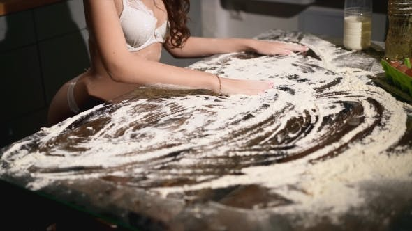 Thumbnail for Sexy Erotic Girl Smudging Flour on Table