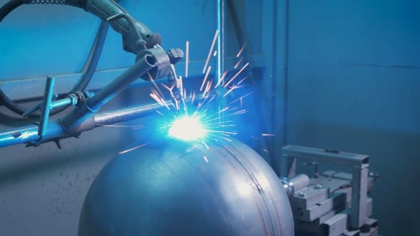 Thumbnail for Arc Welder at Work on the Production. From Electric Discharge Sparks Appear and Scatter in Different