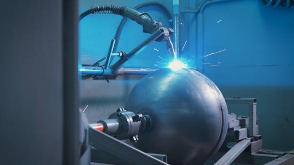 Large Metal Ball Mounted on an Automated Machine for Electro Welding Work on the Production of Parts
