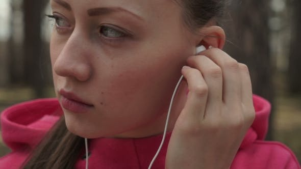 Thumbnail for Girl Puts on Headphones and Turns the Music