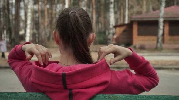 Thumbnail for Beautiful Girl with Long Hairs Puts the Hood