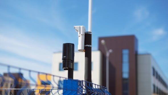 Thumbnail for System of Video Surveillance and Motion Sensors Are Located on the Corner of the Fence. Modern