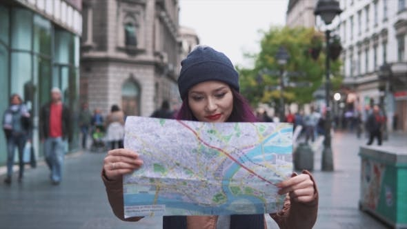 Thumbnail for Woman Tourist Walking with a Map on the Street