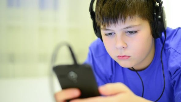 Thumbnail for Teen Using Cell Phone with Headphones