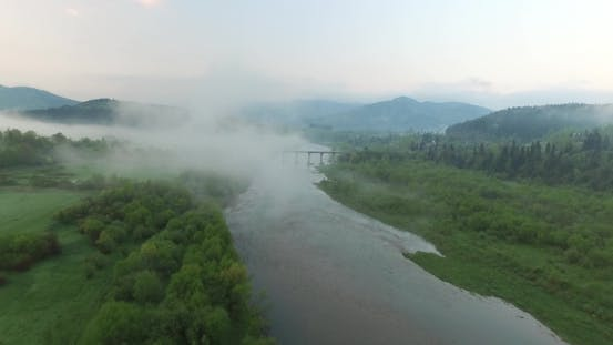 Thumbnail for Bridge Across the River Is Shrouded By Fog. Aerial View
