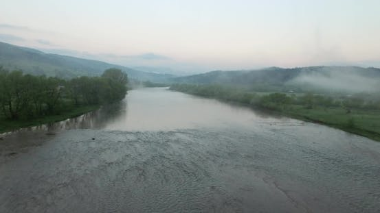 Thumbnail for The Flow of the River in Hilly Terrain. Aerial View