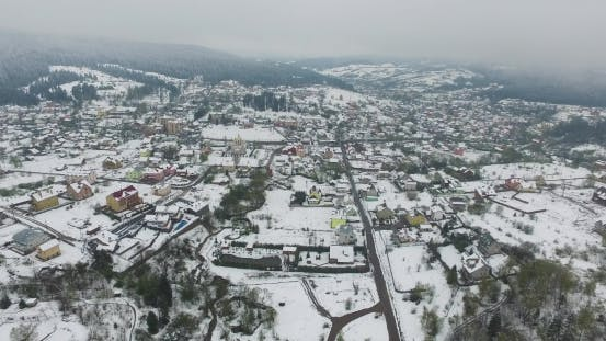 Thumbnail for Aerial View. Snowy Village in the Valley of the Mountains