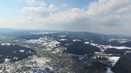 Thumbnail for Aerial View. High Over Snowy Rolling Hills. Small Town