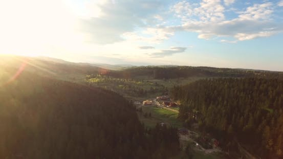 Thumbnail for Sunny Day in a Hilly Wooded Valley. Aerial View