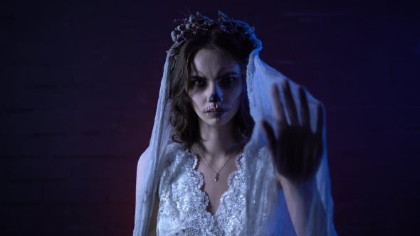Thumbnail for Horror Halloween Scene of a Corpse Bride with Sad Face and Sewed Mouth Looking at the Camera the
