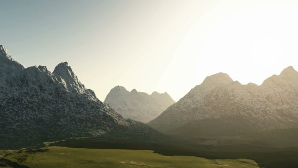Thumbnail for Green Valley and Mountains in Snow at Sunset