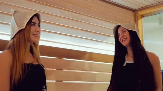 Girls Talk and Laugh in the Sauna