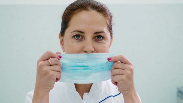 Thumbnail for Doctor Put on a Face a Medical Mask in a Clinic