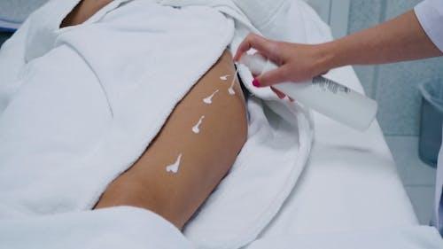 Beautician Prepare Cellulite Removal on Legs