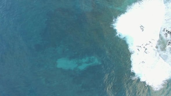 Thumbnail for Aerial Shot of Blue Ocean Surface and Foamy Waves