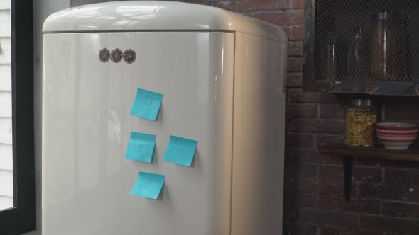 Thumbnail for Young Blonde Standing Near Refrigerator in Flat