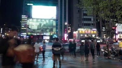 Timelapse of Pedestrians on Zebra Crossing in Night Seoul, South Korea