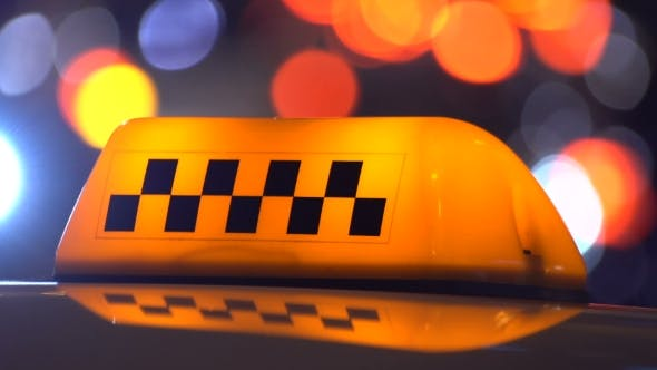 Taxi Sign in Traffic