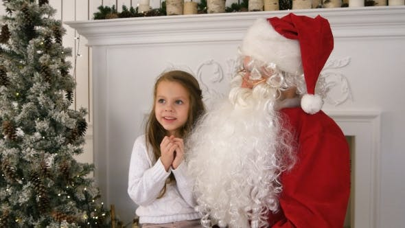 Thumbnail for Undecided Little Girl on Santa Claus Lap Thinking About Her Present