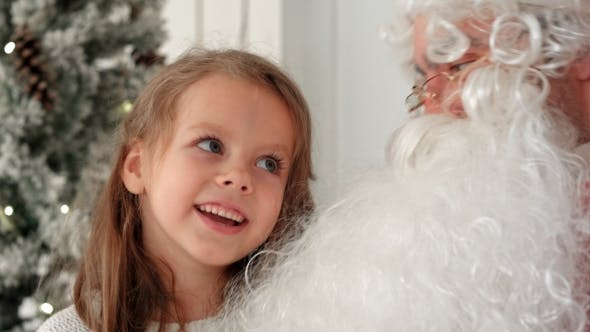 Thumbnail for Cute Little Girl Singing Christmas Song Together with Santa Claus