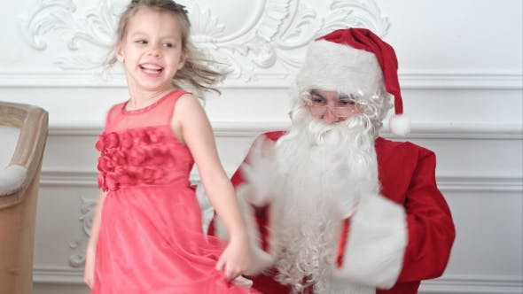 Thumbnail for Santa Claus Clapping His Hands While Pretty Little Girl Dancing Around Him