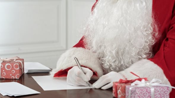 Thumbnail for Santa Claus Answering Christmas Letters Sitting at His Table