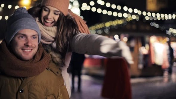 Thumbnail for Happy Couple Dating and Hugging on Christmas