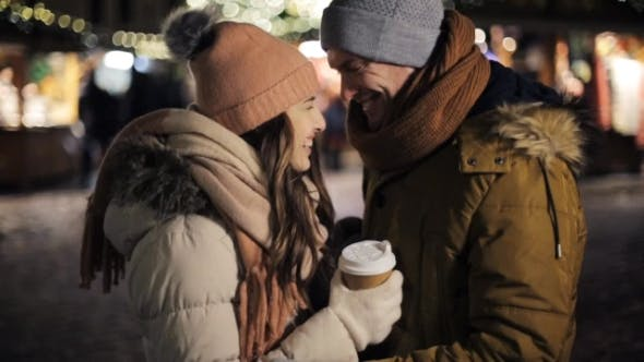 Thumbnail for Happy Couple with Coffee Outdoors on Christmas