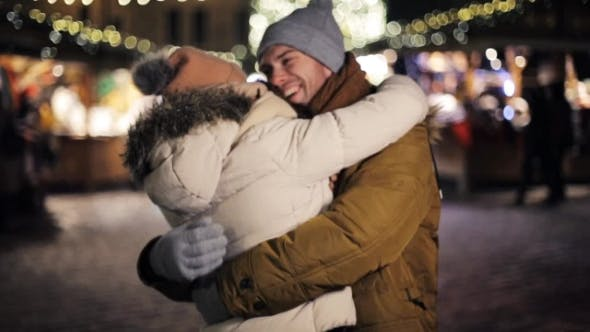 Thumbnail for Happy Couple Meeting and Hugging on Christmas