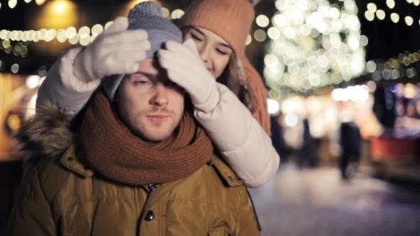 Thumbnail for Happy Couple Having Fun Outdoors on Christmas