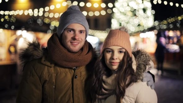 Thumbnail for Happy Couple Hugging at Christmas Market
