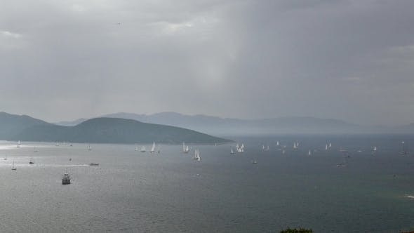 Thumbnail for Sea Scenery with Sailing Yachts in a Cloudy Day