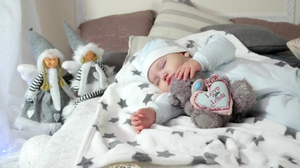 Thumbnail for Child Sleeping on Parents' Bed in a Cozy Atmosphere in the House, Little Boy Asleep Hugging