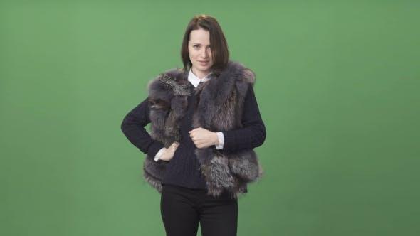 Thumbnail for Young Brunette Woman Demonstrating Fur Vest