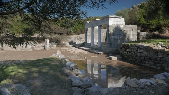 Thumbnail for Facade of the Ancient Temple with Columns Reflection in the Water, Kaunos, Dalyan Valley, Turkey.