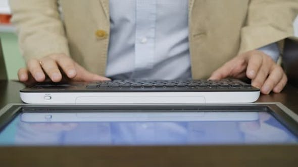 of Handsome Businessman Using Touchpad To Surf Web Pages Online